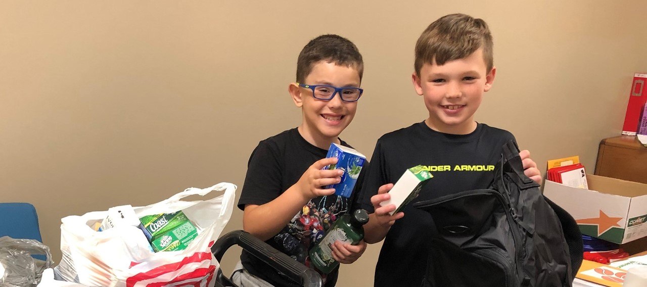 students fill bags with toiletries